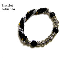 Bracelet de perles noire,argent et argent , il est extensible