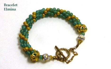 Bracelet de perles vertes avec insertion de perles beige. le fermoir est or ce fermoir est idéal pour les personnes qui ont des douleurs aux mains, il y a aussi une chaine de sécurité.