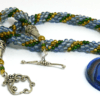 collier de perles vertes avec insertion de perles vertes et or